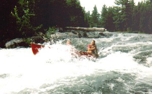 Shooting whitewater rapids.